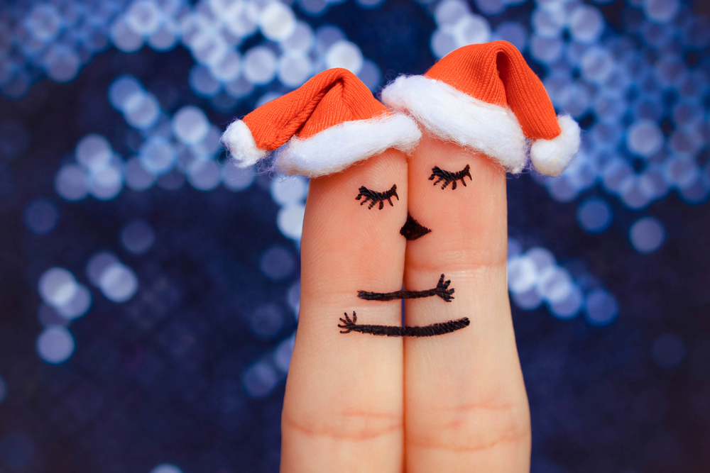 Christmas kissing fingers