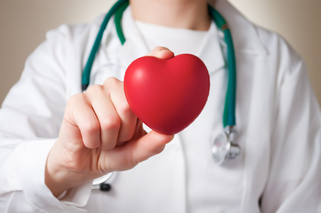 doctor holding a heart to show medical romance